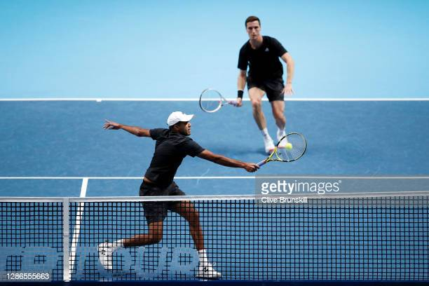 Rajeev Ram of The United States of America and Joe Salisbury of Great Britain in action during their doubles match against Kevin Krawietz of Germany...