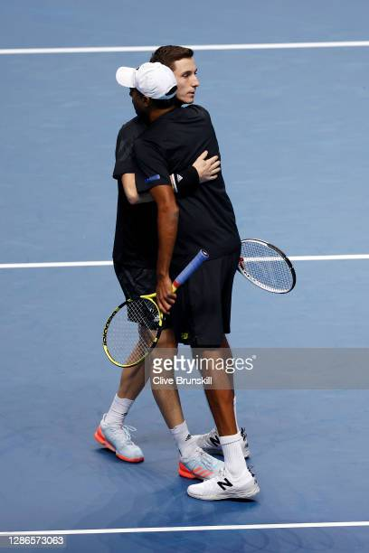 Rajeev Ram of The United States of America and Joe Salisbury of Great Britain celebrate match point and qualifying for the semi finals other during...