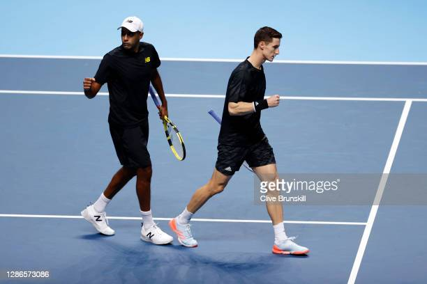 Rajeev Ram of The United States of America and Joe Salisbury of Great Britain celebrate a point during their doubles match against Kevin Krawietz of...