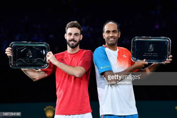 Rajeev Ram of The United States of America and Marcel Granollers of Spain pose for photographs with their trophys after they win their match against...