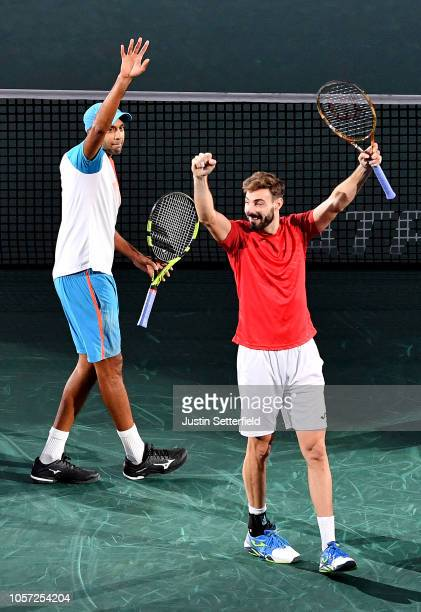 Rajeev Ram of The United States of America and Marcel Granollers of Spain celebrate after they win their match against Horia Tecau of Romania and...