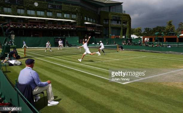 Rajeev Ram of United States and Joe Salisbury of Great Britain in action during their men's doubles second round match against Marton Fucsovics of...