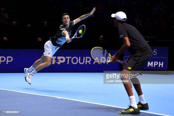 Rajeev Ram of USA and Joe Salisbury of Great Britain in action against Raven Klasen of South Africa and Michael Venus of New Zealand during Day 1 of...