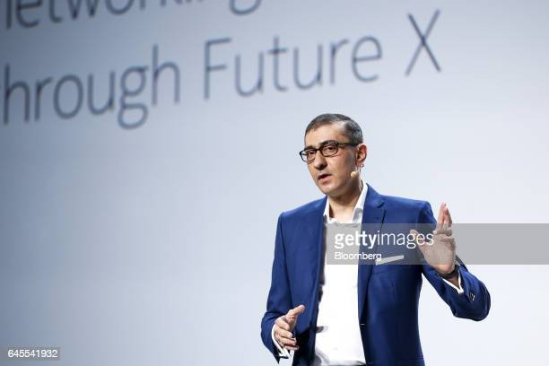 Rajeev Suri, chief executive officer of Nokia Oyj, gestures while speaking during a news conference ahead of the Mobile World Congress in Barcelona,...
