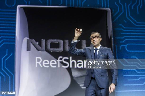 Rajeev Suri president and chief executive officer of Nokia Oyj presents the ReefShark chipset during a special event ahead of the Mobile World...