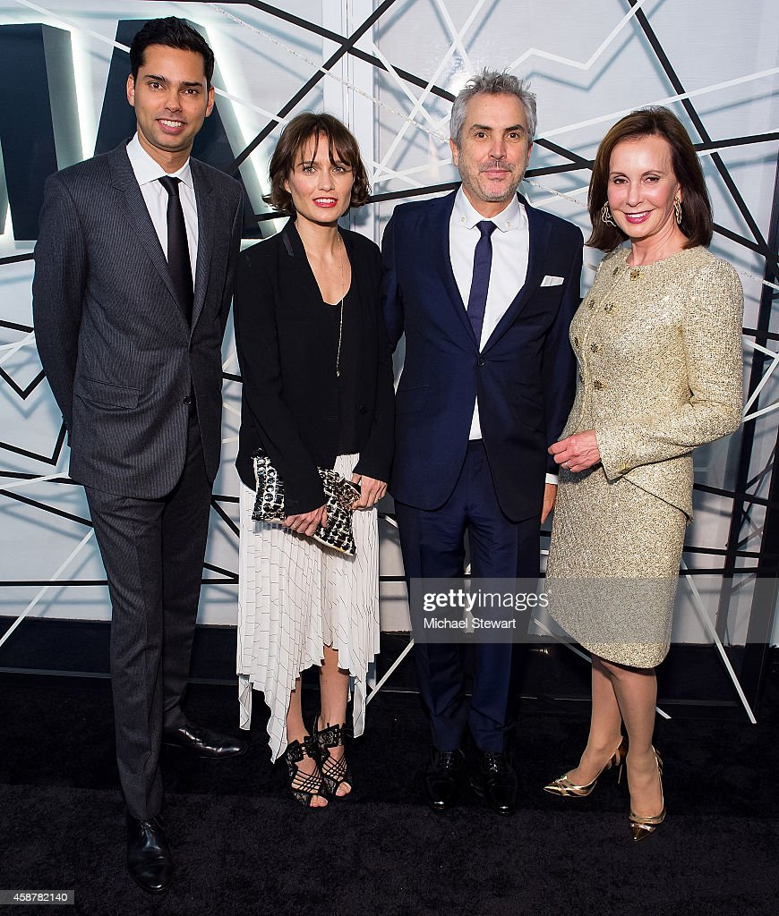 Rajendra Roy (L) and Alfonso Cuaron (2nd from R) attend the Museum of Modern Art Film Benefit's Tribute To Alfonso Cuaron at Museum of Modern Art on November 10, 2014 in New York City.