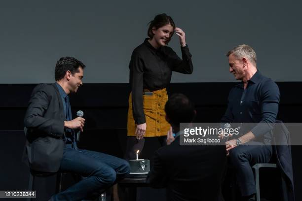 Rajendra Roy presents Actor Daniel Craig with a birthday cake at The Museum of Modern Art Screening of Casino Royale at MOMA on March 03 2020 in New...