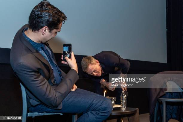 Rajendra Roy takes a photo of Actor Daniel Craig blowing out his birthday cake at The Museum of Modern Art Screening of Casino Royale at MOMA on...
