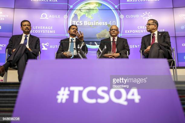 Rajesh Gopinathan chief executive officer and managing director of Tata Consultancy Services Ltd second left speaks as Ajoy Mukherjee executive vice...