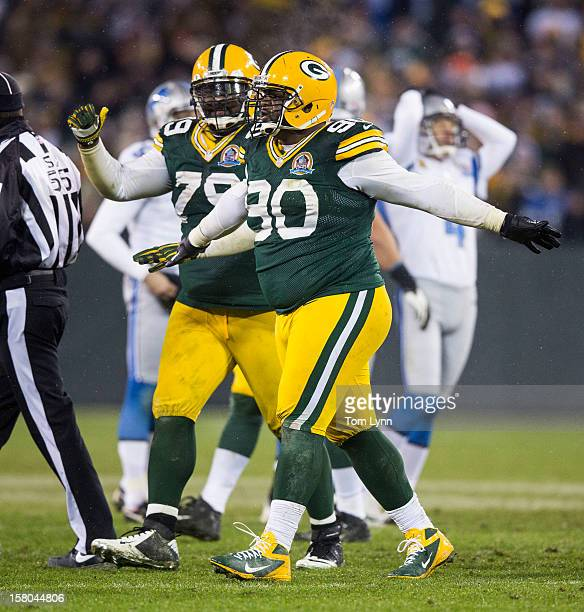 Raji and Ryan Pickett of the Green Bay Packers signal no good as Jason Hanson of the Detroit Lions reacts to his missed field goal at Lambeau Field...
