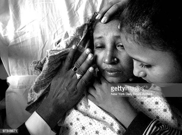 Rajiah Sultana who is in desperate need of a liver is comforted by her family in her hospital bed at Bellevue Hospital
