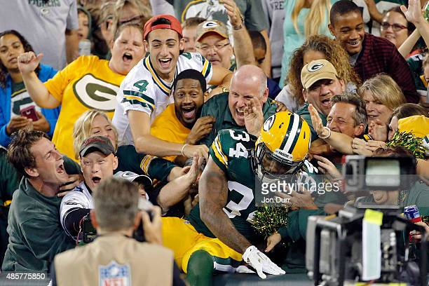 Rajion Neal of the Green Bay Packers celebrates his touchdown reception against the Philadelphia Eagles with fans during the second quarter in a...
