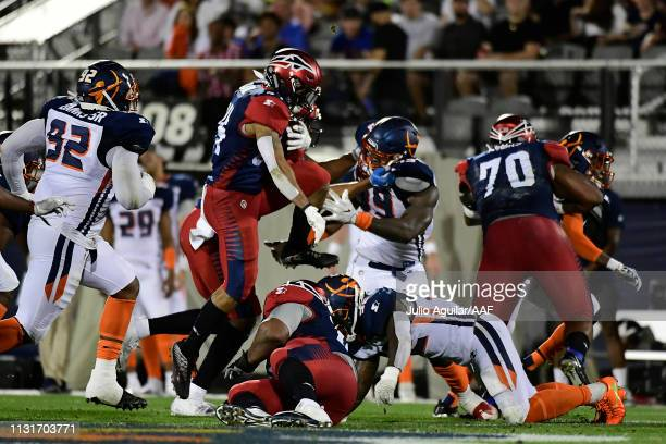 Rajion Neal of the Memphis Express leaps over other players as they take on the Orlando Apollos during the second quarter of the Alliance of American...