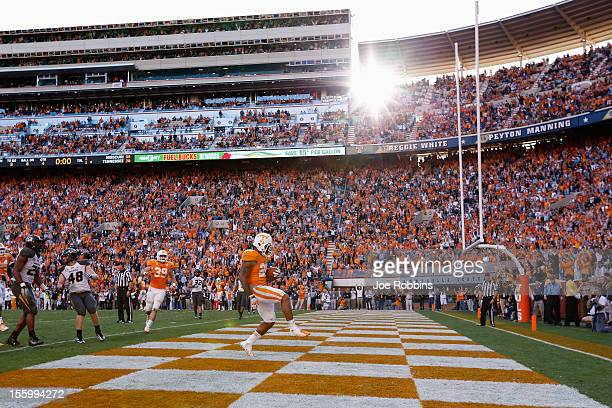 Rajion Neal of the Tennessee Volunteers runs into the end zone with an eightyard touchdown reception in the first overtime against the Missouri...