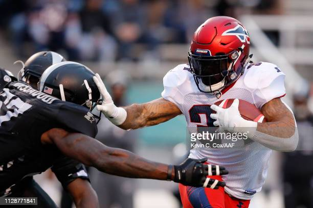Rajion Neal of Memphis Express is brought down by Jonathan Massaquoi of Birmingham Iron during an Alliance of American Football game at Legion Field...