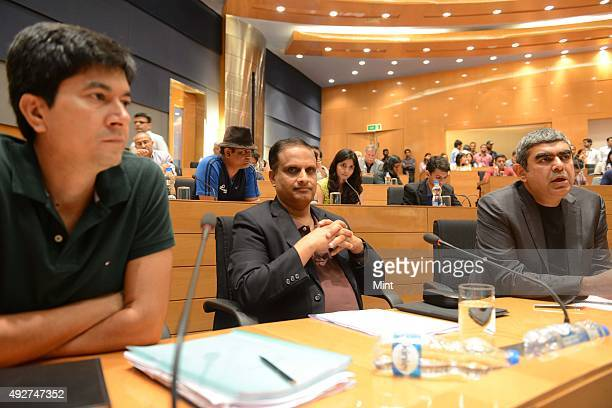 Rajiv Bansal EVP and CFO U B Pravin Rao COO and Vishal Sikka CEO and MD Infosys during a media brief on Infosys Q2 results on February 6 2013 in...