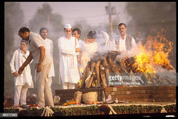 Rajiv Gandhi and mourners gather during the cremation of Indira Gandhi on November 3 1984 in India
