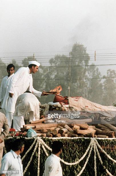 Rajiv Gandhi lights the funeral pyre of his mother Prime Minister Indira Gandhi who was assassinated by Sikh separatists Rajiv Gandhi succeeded his...