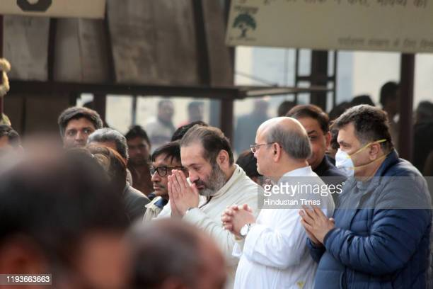 Rajiv Kapoor and Rishi Kapoor at the funeral of Ritu Nanda at Lodhi Road Crematorium on January 14 2020 in New Delhi India Ritu Nanda late actor Raj...