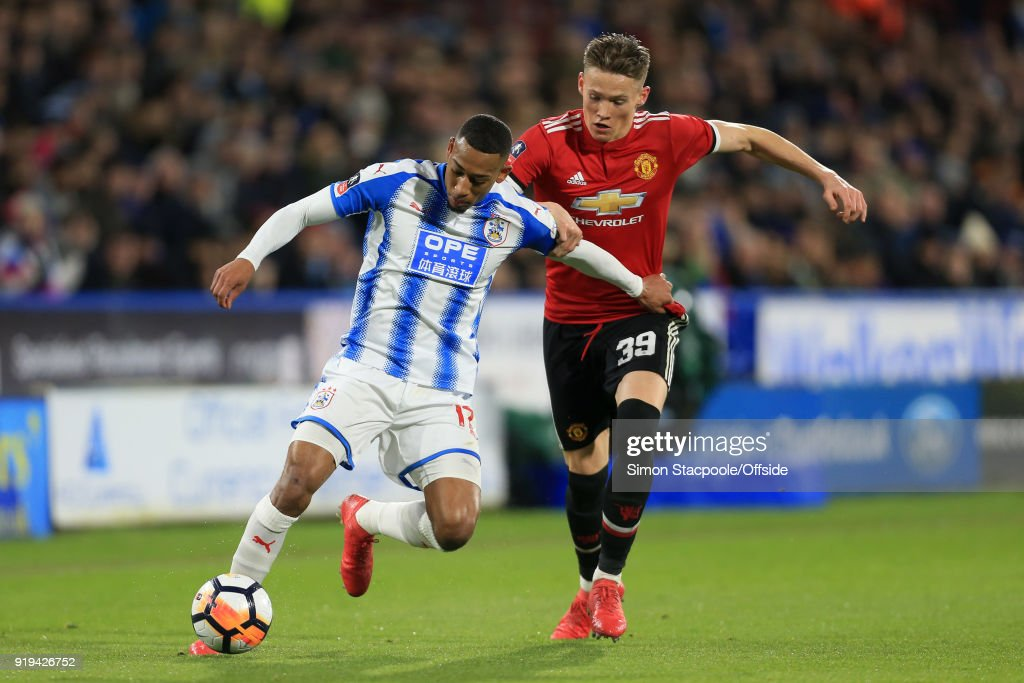 Rajiv van La Parra of Huddersfield battles with Scott McTominay of Man Utd during The Emirates FA Cup Fifth Round match between Huddersfield Town and Manchester United at the John Smith's Stadium on February 17, 2018 in Huddersfield, England.
