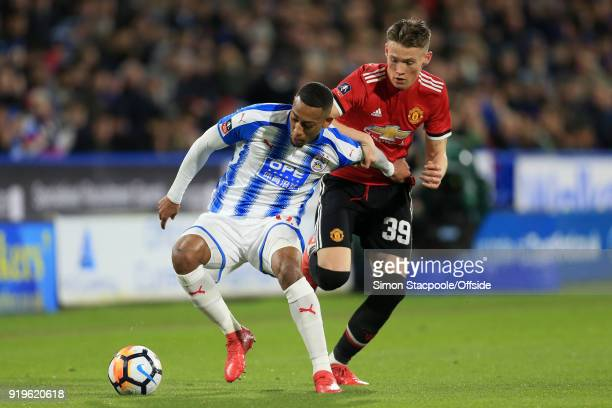 Rajiv van La Parra of Huddersfield battles with Scott McTominay of Man Utd during The Emirates FA Cup Fifth Round match between Huddersfield Town and...