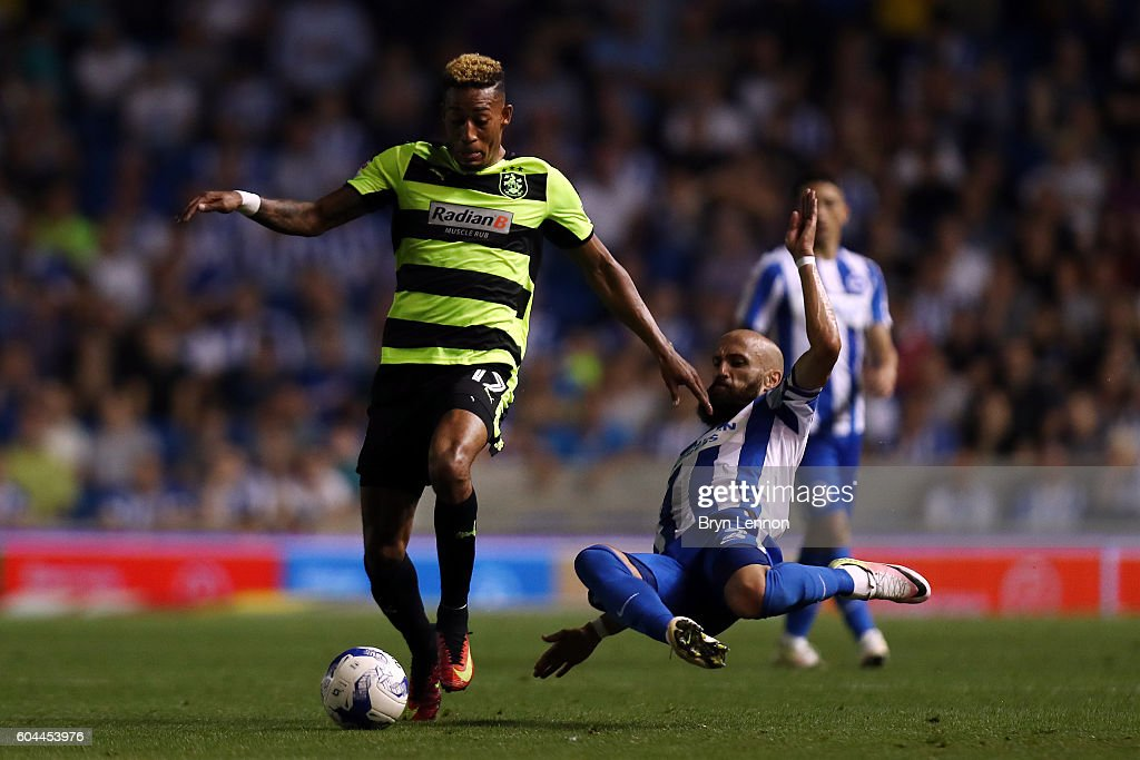 Rajiv van La Parra of Huddersfield is tackled by Bruno Saltor of Brighton during the Sky Bet Championship match between Brighton & Hove Albion and Huddersfield Town at the Amex Stadium on September 13, 2016 in Brighton, England.
