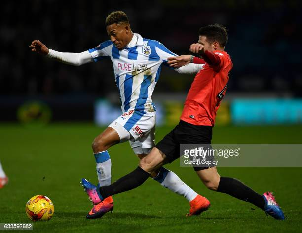 Rajiv Van la Parra of Huddersfield is tackled by Oliver Norwood of Brighton during the Sky Bet Championship match between Huddersfield Town and...