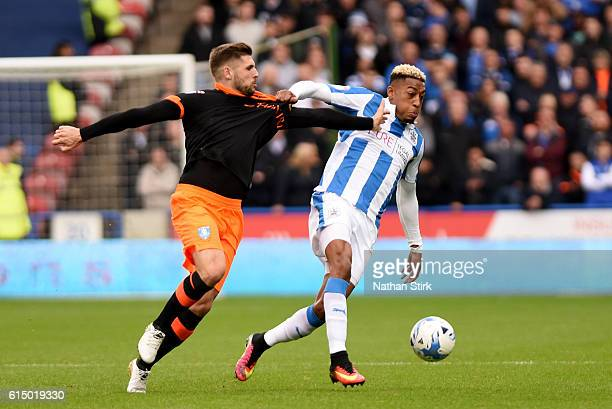 Rajiv van La Parra of Huddersfield Town and Barry Bannan of Sheffield Wednesday in action during the Sky Bet Championship match between Huddersfield...