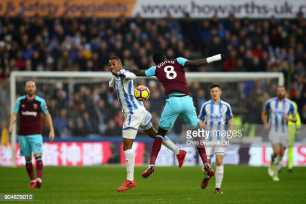 Rajiv van La Parra of Huddersfield Town and Cheikhou Kouyate of West Ham United challenged for the ball during the Premier League match between...