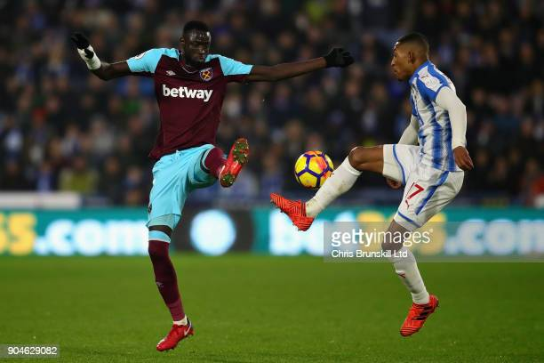 Rajiv van La Parra of Huddersfield Town and Cheikhou Kouyate of West Ham United battle for the ball during the Premier League match between...
