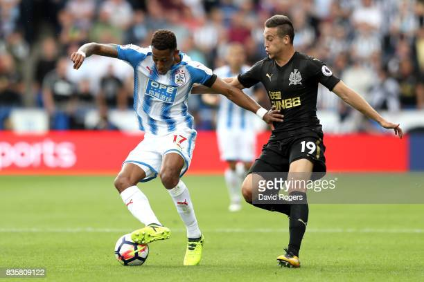 Rajiv van La Parra of Huddersfield Town and Javi Manquillo of Newcastle United battle for possession during the Premier League match between...