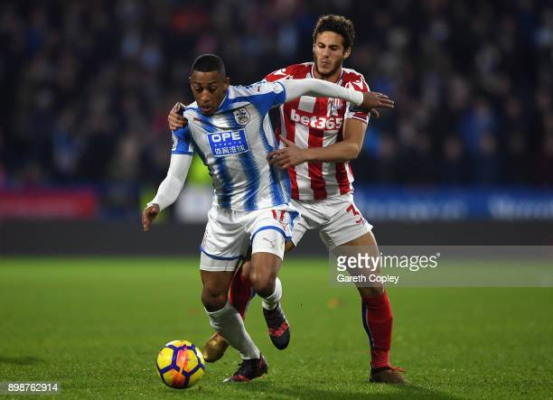 Rajiv van La Parra of Huddersfield Town and Ramadan Sobhi of Stoke City battles for possesion during the Premier League match between Huddersfield...
