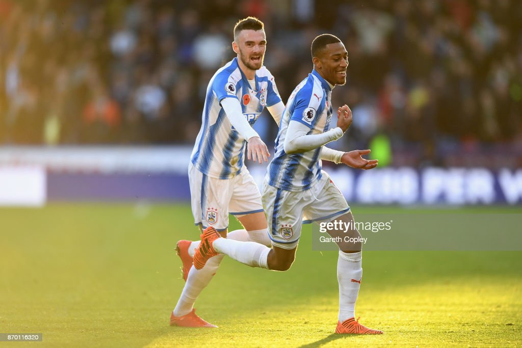 Rajiv van La Parra of Huddersfield Town celebrates with team mates after scoring his sides first goal during the Premier League match between Huddersfield Town and West Bromwich Albion at John Smith's Stadium on November 4, 2017 in Huddersfield, England.