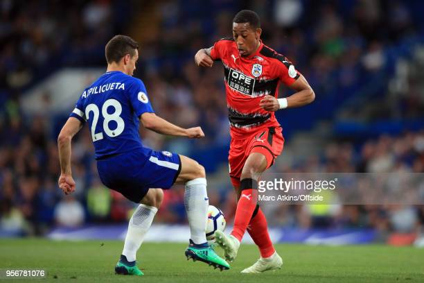 Rajiv van La Parra of Huddersfield Town in action with Cesar Azpilicueta of Chelsea during the Premier League match between Chelsea and Huddersfield...