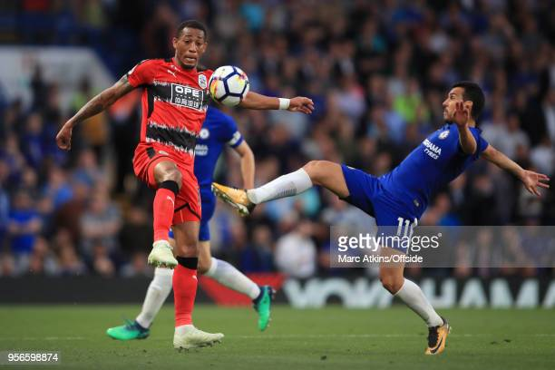 Rajiv van La Parra of Huddersfield Town in action with Pedro of Chelsea during the Premier League match between Chelsea and Huddersfield Town at...