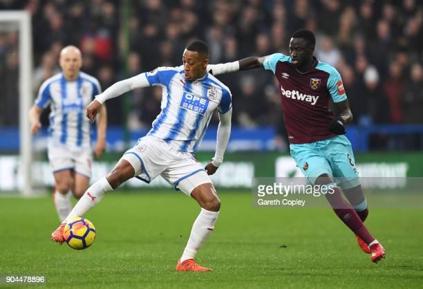 Rajiv van La Parra of Huddersfield Town is challenged by Cheikhou Kouyate of West Ham United during the Premier League match between Huddersfield...