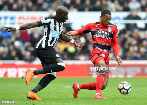 Rajiv van La Parra of Huddersfield Town is challenged by Mohamed Diame of Newcastle United during the Premier League match between Newcastle United...