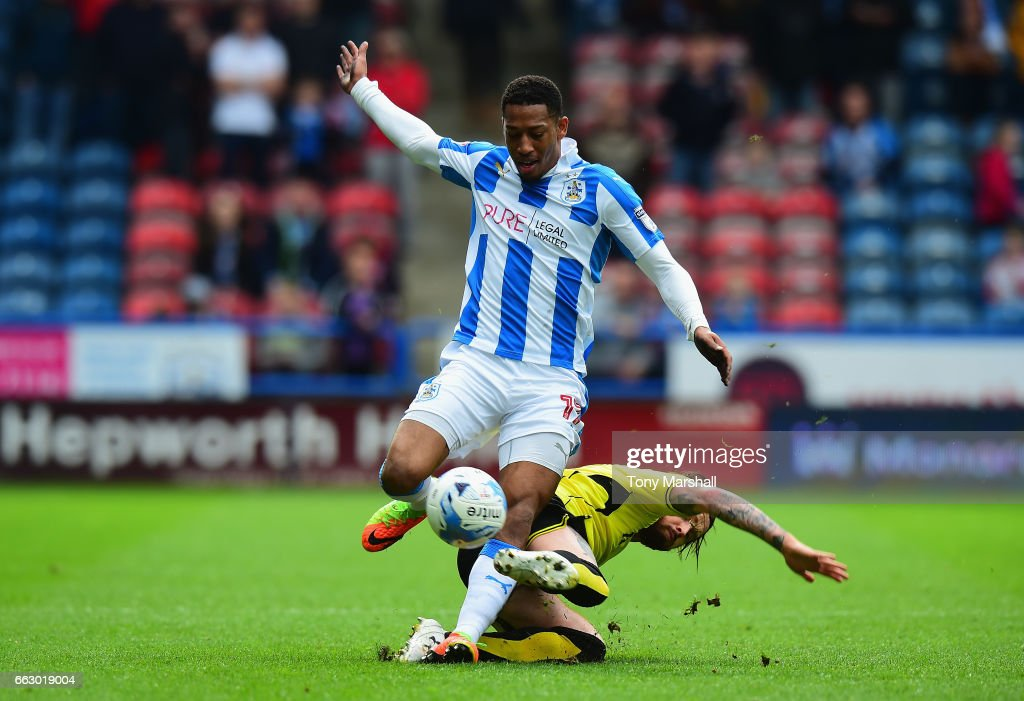 Rajiv Van La Parra of Huddersfield Town is tackled by John Brayford of Burton Albion during the Sky Bet Championship match between Huddersfield Town and Burton Albion at the John Smiths Stadium Stadium on April 1, 2017 in Huddersfield, England.