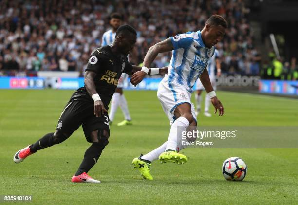Rajiv van la Parra of Huddersfield Town moves away from Christian Atsu during the Premier League match between Huddersfield Town and Newcastle United...
