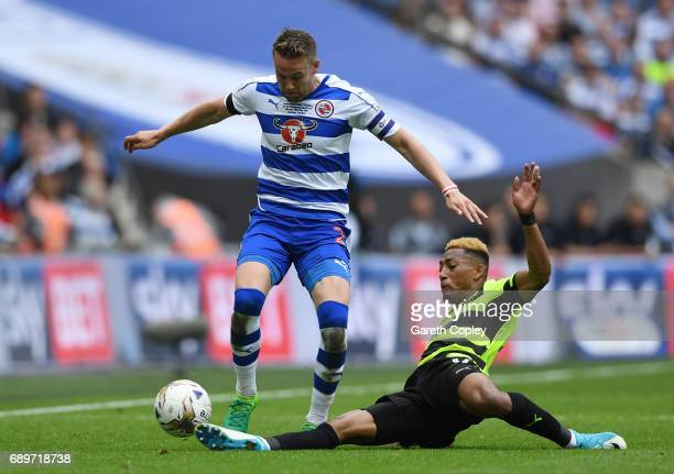 Rajiv van La Parra of Huddersfield Town tackles Chris Gunter of Reading during the Sky Bet Championship play off final between Huddersfield and...