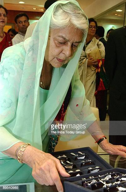 Rajmata Gayatri Devi looks at jewelry in an undated photo.