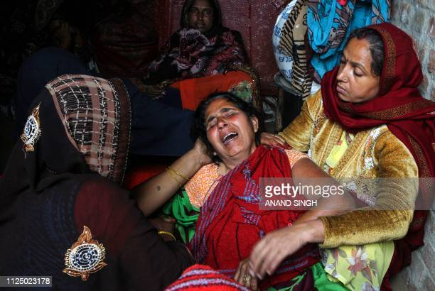 Rajmati Devi mours her son slain Central Reserve Police Force trooper Ramesh Yadav in a village some kms from Varanasi in the Indian state Uttar...