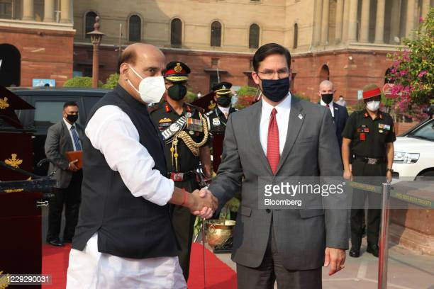 Rajnath Singh, India's defense minister, center left, shakes hands with Mark Esper, U.S. Secretary of defense, during a ceremonial reception at the...