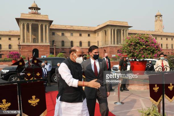 Rajnath Singh, India's defense minister, center left, welcomes Mark Esper, U.S. Secretary of defense, during a ceremonial reception at the South...