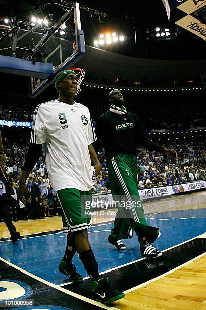 Rajon Rondo and Keivn Garnett of the Boston Celtics walks off the court dejected after they lost 11392 against the Orlando Magic in Game Five of the...