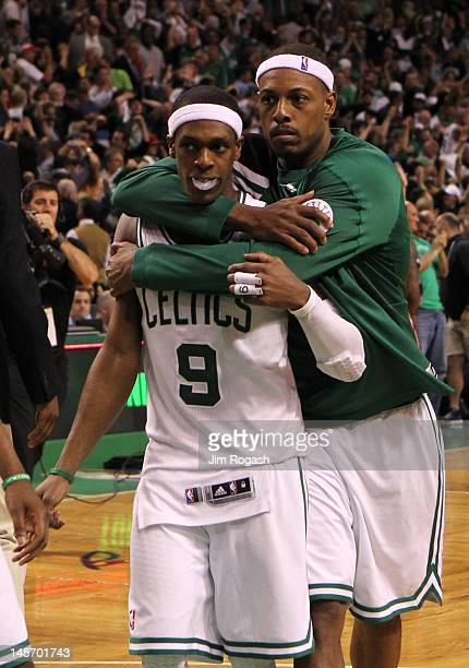 Rajon Rondo and Paul Pierce of the Boston Celtics celebrate after they won 9391 in overtime against the Miami Heat in Game Four of the Eastern...