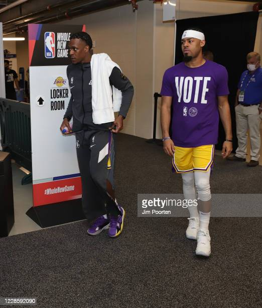 Rajon Rondo and Quinn Cook of the Los Angeles Lakers heads to the court after halftime against the Denver Nuggets in Game one of the Western...