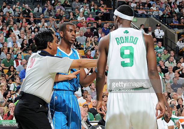 Rajon Rondo of Boston Celtics talks to Chris Paul of the New Orleans Hornets on November 1 2009 at the TD Garden in Boston Massachusetts NOTE TO USER...