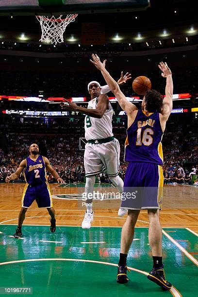 Rajon Rondo of the Boston Celltics passes the ball behind his head against Pau Gasol of the Los Angeles Lakers during Game Four of the 2010 NBA...