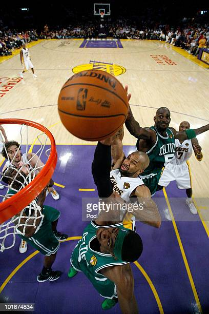 Rajon Rondo of the Boston Celtics and Derek Fisher of the Los Angeles Lakers go after the ball in Game Two of the 2010 NBA Finals at Staples Center...